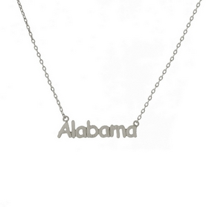 "Dainty silver tone necklace with an Alabama pendant. Approximately 16"" in length."