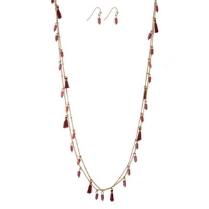 "Gold tone wrap necklace set with red tassels and beads and matching fishhook earrings. Approximately 60"" in length."
