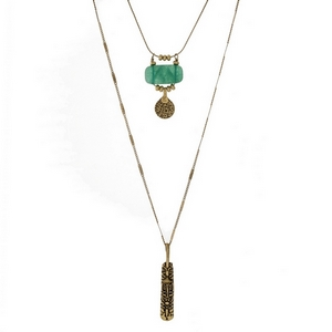 "Burnished gold tone two layer necklace with a green natural stone and a hammered metal pendant. Approximately 20"" to 28"" in length."