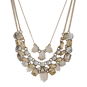 "Gold tone three layer necklace with clear, blush, and ivory rhinestones. Approximately 18"" to 20"" in length."