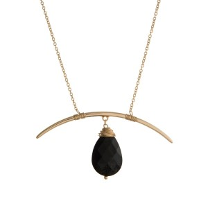 "Gold tone necklace with a horn pendant and a faceted black natural stone. Approximately 26"" in length."