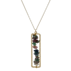 "Gold tone necklace with a hunter green chip stone pendant. Approximately 32"" in length."