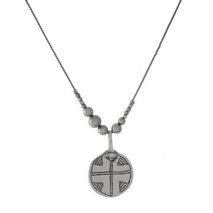 """Silver tone necklace with a circle pendant, stamped with a cross. Approximately 30"""" in length."""