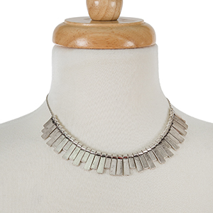 "Silver tone necklace with burnished fringe. Approximately 16"" in length."