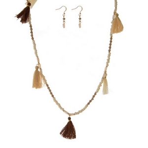 "Ivory beaded necklace with brown and ivory tassels. Approximately 36"" in length."