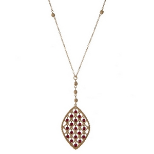 "Gold tone necklace with a burgundy beaded oval shaped pendant. Approximately 32"" in length."