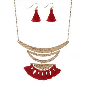 "Gold tone necklace set with red thread tassels and matching fishhook earrings. Approximately 16"" in length."