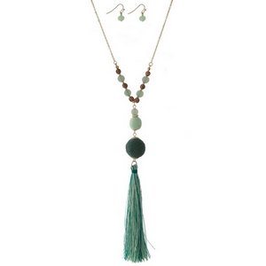 "Gold tone necklace set with green thread wrapped beads and a two tone thread tassel. Approximately 30"" in length."