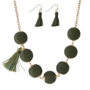 "Gold tone necklace set with olive green thread wrapped beads, tassel accents and matching fishhook earrings. Approximately 16"" in length."