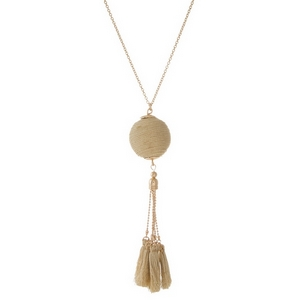 "Gold tone necklace with a metallic gold thread wrapped pendant and thread tassels. Approximately 30"" in length."
