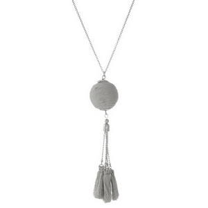 "Silver tone necklace with a metallic silver thread wrapped pendant and thread tassels. Approximately 30"" in length."