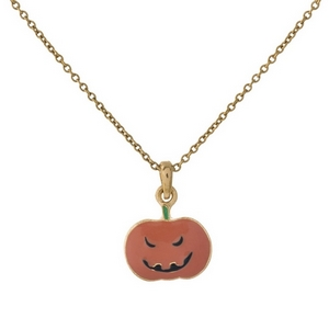 """Dainty gold tone necklace with a Jack-O-Lantern pendant. Approximately 16"""" in length."""