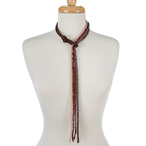 "Brown faux leather necklace with burgundy, ivory, and bronze beads. Adjustable up to 18"" in length."