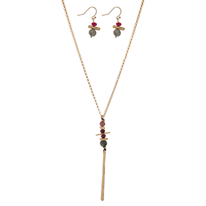 "Gold tone necklace set with a green and burgundy beaded pendant and matching fishhook earrings. Approximately 32"" in length."