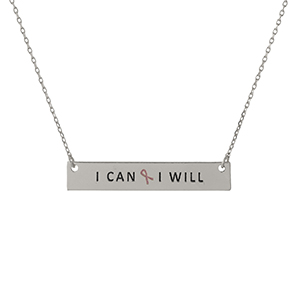 "Dainty silver tone, Breast Cancer Awareness necklace with a bar pendant, stamped with ""I Can & I Will."" Approximately 16"" in length."