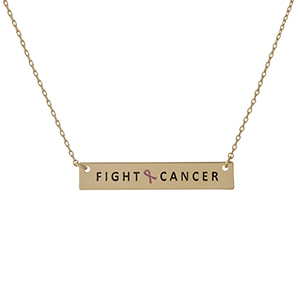 "Dainty gold tone, Breast Cancer Awareness necklace with a bar pendant, stamped with ""Fight Cancer."" Approximately 16"" in length."