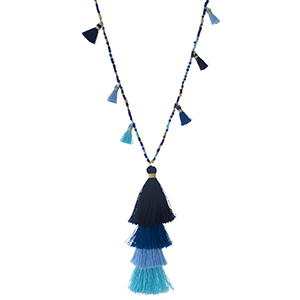 "Shades of blue beaded necklace with a blue ombre, tiered tassel pendant. Approximately 30"" in length."