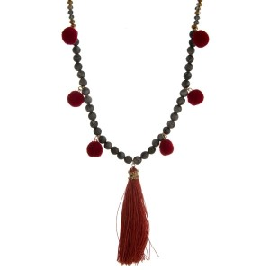 "Faceted and natural stone beaded necklace with pom pom accents along the body and a thread tassel. Approximately 30"" in length."