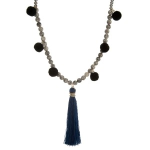 """Faceted and natural stone beaded necklace with pom pom accents along the body and a thread tassel. Approximately 30"""" in length."""