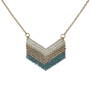 "Dainty gold tone necklace with a gold and teal beaded arrow pendant. Approximately 16"" in length."