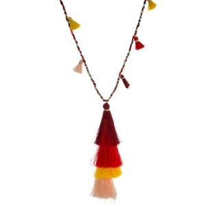 "Shades of red beaded necklace with a red ombre, tiered tassel pendant. Approximately 30"" in length."