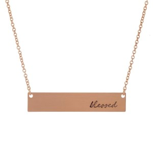 """Dainty rose gold tone necklace with a bar pendant, stamped with """"blessed."""" Approximately 16"""" in length."""