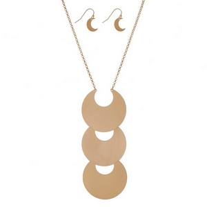 "Metal necklace set with a three tier, crescent pendant and matching fishhook earrings. Approximately 28"" in length."