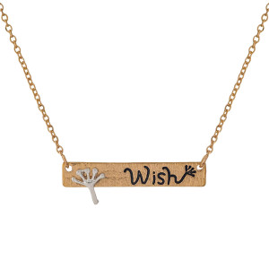"Dainty gold tone necklace with a bar pendant, stamped with ""Wish."" Approximately 16"" in length."