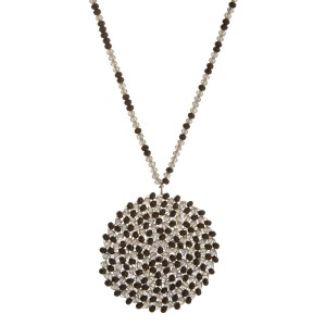"Long statement necklace with a beaded, circle pendant and a full beaded chain. Approximately 34"" in length."