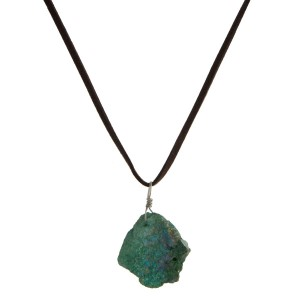 "Faux suede cord necklace with a crystal, natural stone pendant. Pendant sizes may vary. Approximately 16"" in length."