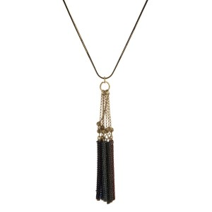 "Burnished gold tone necklace with a chain wrapped, bar tassel pendant. Approximately 32"" in length."