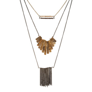"Burnished gold tone, three layer necklace with natural stones and a fringe tassel. Approximately 26"" to 34"" in length."