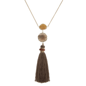 "Gold tone necklace with a natural druzy stone and thread tassel pendant. Approximately 30"" in length."