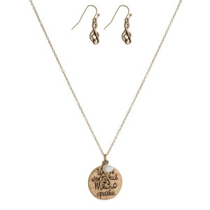 "Dainty necklace set with a circle pendant, stamped with ""Where words fail, music speaks"" and matching earrings. Approximately 16"" in length."