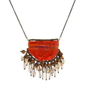 "Burnished gold tone necklace with a natural stone pendant, accented with beaded fringe. Approximately 30"" in length."