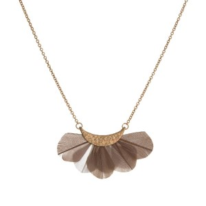 "Dainty gold tone necklace with a fanned, feather pedant. Approximately 16"" in length."