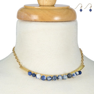 "Gold tone necklace with a curved bar pendant and wire-wrapped, natural stone beads. Approximately 14"" in length."