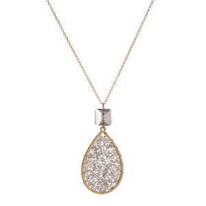 "Dainty gold tone necklace with a beaded teardrop pendant. Approximately 28"" in length."