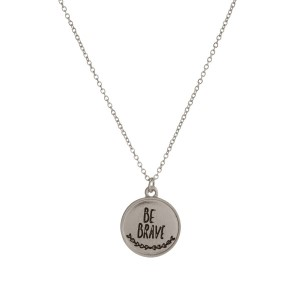 "Dainty metal necklace with a circle pendant, stamped with ""Be Brave."" Approximately 16"" in length. Necklace comes with a pouch, perfect for gifting!"