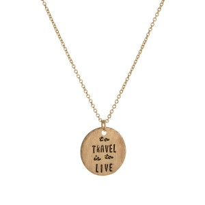 "Dainty metal necklace with a circle pendant, stamped with ""to travel is to live."" Approximately 16"" in length. Necklace comes with a pouch, perfect for gifting!"
