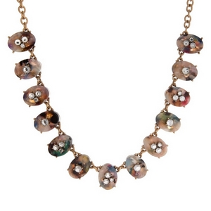 "Gold tone necklace with oval tortoise shell shapes and clear rhinestone accents. Approximately 16"" in length."