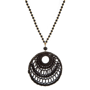 "Gold tone necklace with a crocheted circle pendant. Approximately 30"" in length."