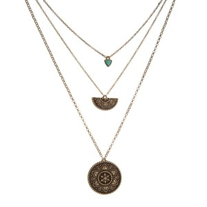 "Dainty three layer necklace with bohemian pendants. Approximately 16"" to 20"" in length."