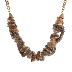 """Gold tone necklace with braided strands of multicolored beads and beaded accents. Approximately 16"""" in length."""