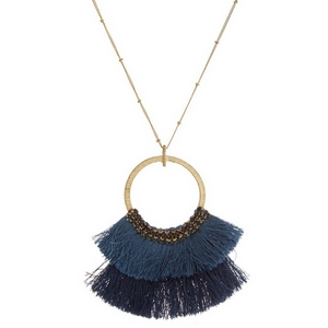 "Burnished gold tone necklace with an open circle pendant, ombre fanned tassels and rhinestone accents. Approximately 32"" in length."