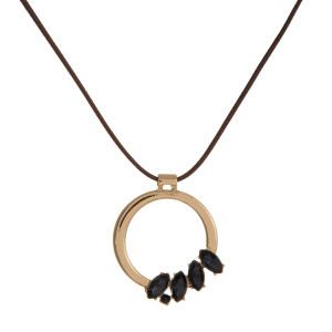 """Brown, waxed cord necklace with a gold tone circle pendant accent with rhinestones. Adjustable up to 30"""" in length."""