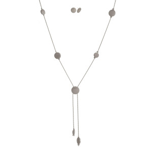 "Dainty, metal necklace set with circle stationaries, matching stud earrings, and a satin finish. Approximately 30"" in length."