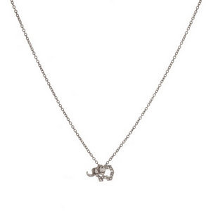 "Dainty metal necklace with a cutout, elephant pendant. Approximately 16"" in length."