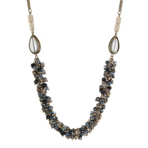 """Burnished gold tone necklace with teardrop beads and ombre faceted beads. Approximately 30"""" in length."""