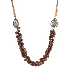 "Burnished gold tone necklace with teardrop beads and ombre faceted beads. Approximately 30"" in length."